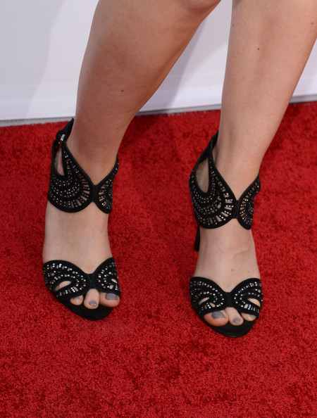 Erin Moriarty showed off her gray pedi with a pair of Art Deco-inspired evening sandals.