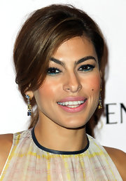 Eva Mendes added sexy sweeps of teal eyeliner to create a bright dramatic look for a screening of 'Girl In Progress.'