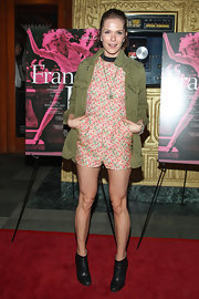 Katie Aselton chose an army green utility jacket to pair over her floral romper for a cool mix of masculine and feminine looks.