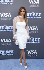 Jennifer Lopez polished off her all-white look with a Tyler Alexandra envelope clutch.