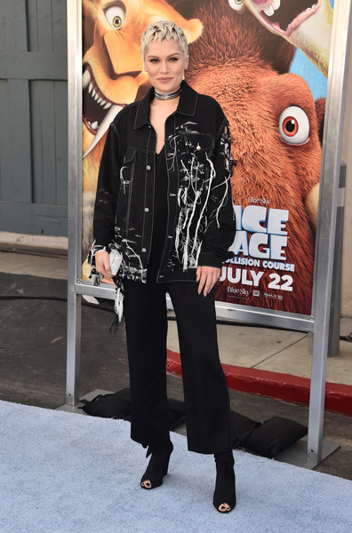 Jessie J got majorly edgy in a distressed denim jacket layered over a loose jumpsuit at the screening of 'Ice Age: Collision Course.'