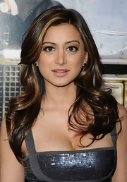 Noureen DeWulf had her mild curls styled in feathered flip for 'The Lincoln Lawyer' screening.