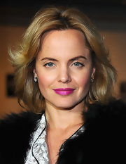 Mena Suvari attended the premiere of 'Goon' wearing bold fuchsia lipstick.