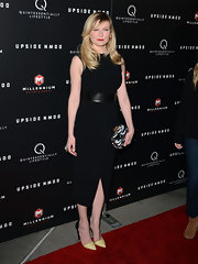 Kirsten Dunst opted for a sleek little black dress with a wide leather belt while attending the 'Upside Down' screening.