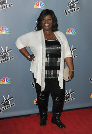 Retta brought out some major bling with this white cardigan that was trimmed in silver sequins.