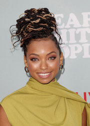 Logan Browning attended the screening of 'Dear White People' season 2 wearing her dreadlocks piled high on top of her head.