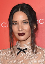 Olivia Munn went for a prominent pout with dark red lipstick.