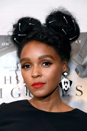 Janelle Monae looked funky with her safety pin-adorned pigtail buns at the screening of 'Hidden Figures.'