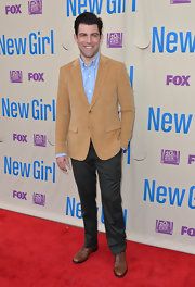 Max Greenfield looked cool and casual in a tan velour blazer and jeans.