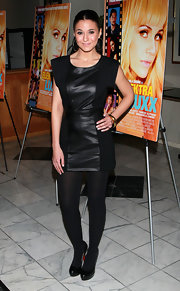 Emmanuelle dons a leather LBD with opaque tights to the screening of 'Elektra Luxx' in LA.