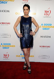 Michelle Borth sparkled in a midnight blue shift dress. The simple silhouette was amplified by the elaborate sequined beading.