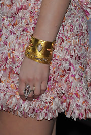 Leighton Meester wore a gold bangle bracelet complete with coral stones to the premiere of 'Country Strong'.