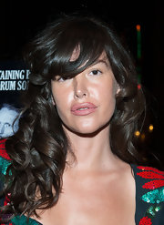 Paz de la Huerta wore her hair in thick, bouncy curls with eye-grazing bangs at the screening of 'Beware of Mr. Baker.'