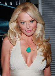 Charlotte Ross added a pop of color to her plunging neckline with a turqouise gemstone pendant.