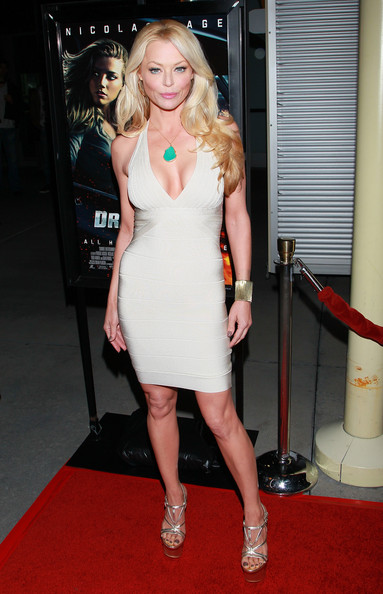 Charlotte Ross dazzled in strappy gold sandals with super stacked platforms.