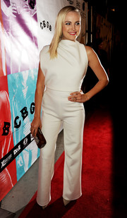 Malin Akerman made an ultra-stylish choice with this high-neck white Osman jumpsuit at the 'CBGB' premiere.