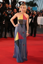 Sienna Miller brought a touch of whimsy to the 'Sea of Trees' Cannes red carpet with this Valentino Couture color-block halter gown.