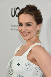 Emilia Clarke sported a messy center-parted updo at the launch of the Parker Institute for Cancer Immunotherapy.