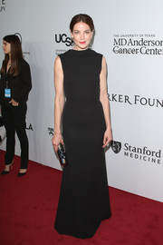 Michelle Monaghan went for minimalist elegance in a sleeveless black gown by Victoria Beckham during the launch of the Parker Institute for Cancer Immunotherapy.