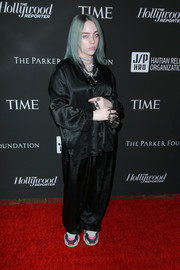 Billie Eilish punctuated her black outfit with a pair of colorful sneakers.