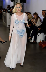 Lafee titillated in a sheer white maxi dress embellished with blue beads.
