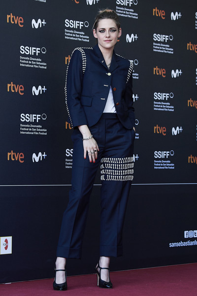 Kristen Stewart looked perfectly polished at the San Sebastian Film Festival premiere of 'Seberg' in a navy Thom Browne pantsuit that was embellished with white laces on the shoulders, sleeves, and leg.
