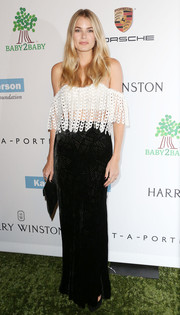 Tori Praver paired her top with a long black velvet burnout skirt for an elegant finish.