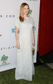 Drew Barrymore looked airy and elegant in an embellished white evening dress by Tory Burch at the Baby2Baby Gala.