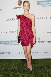 Rosie Huntington-Whiteley looked like a flower in bloom in this ruffled burgundy one-shoulder dress by Isabel Marant during the Baby2Baby Gala.