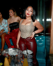 Jordyn Woods sizzled in a taupe Gucci corset top and red leather pants at the Celebrate the Culture II event.