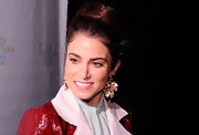 Nikki Reed attended fashion week in NYC wearing her hair in a large loose bun.