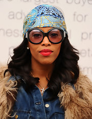 June Ambrose hit the Lincoln Center for Day 8 of Fall 2011 MBFW wearing an unusual ensemble featuring a printed bandana around her head.
