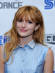 Bella Thorne wore her hair in a partially braided style with subtle waves when she attended the Sega Go Dance unveil party.