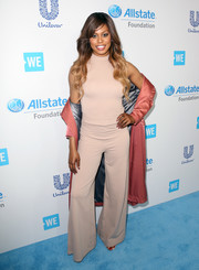 Laverne Cox kept it relaxed yet stylish in a nude jumpsuit layered under a salmon duster during WE Day California.
