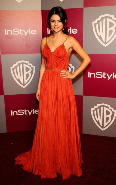 Selena Gomez Evening Dress [dress,clothing,shoulder,red carpet,gown,fashion model,carpet,red,fashion,a-line,arrivals,selena gomez,actress,hotel,beverly hills,instyle,warner brothers,golden globes party,post-party,warner bros. 68th annual golden globe awards]