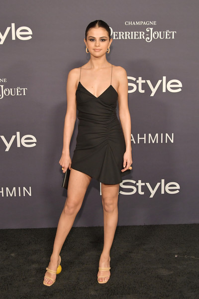 Selena Gomez Strappy Sandals [fashion model,little black dress,dress,cocktail dress,catwalk,flooring,shoulder,fashion show,joint,fashion,arrivals,selena gomez,the getty center,los angeles,california,3rd annual instyle awards]