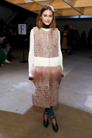Olivia Palermo looked lavish in a blush-colored mixed-fur gilet by Cara Mila at the Self-Portrait fashion show.