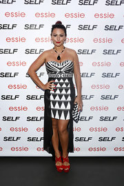 Jenni stunned in a strapless black-and-white fishtail dress with abstract, geometric-prints.