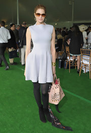 Stephanie Seymour accessorized with a stylish nude cutout leather tote at the Sentebale Royal Salute Polo Cup.