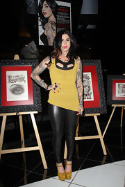 Kat Von D kept her style sexy with a pair of skintight black leather like leggings.