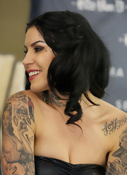 Kat Von D wore her hair in soft spiral curls while promoting her art show at a Sephora store in Chicago.