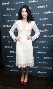 Kat Von D stepped into her solo art show at Sephora in Soho wearing big brown platform Mary Janes.