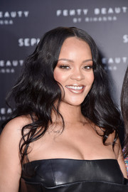 Rihanna wore her hair down in soft waves at the Sephora Loves Fenty Beauty launch.