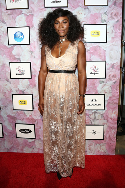 Serena Williams displayed her incredibly toned physique in a sheer nude gown of her own design during her fashion show.