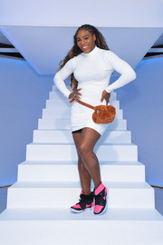 Serena Williams showed off her athletic body in a fitted white sweater dress from her own label while visiting Beautycon POP.