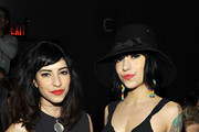 Lisa Origliasso (L) and Jessica Origliasso of The Veronicas attend the Sergio Davila Fall 2011 fashion show during Mercedes-Benz Fashion Week at The Studio at Lincoln Center on February 15, 2011 in New York City.