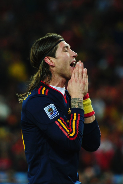Sergio Ramos Headband [player,championship,sports,team sport,ball game,team,gesture,competition event,tournament,sports equipment,sergio ramos,spain,2010 fifa world cup south africa,south africa,johannesburg,soccer city stadium,netherlands,2010 fifa world cup final,match]