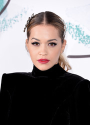 Rita Ora went for a bold beauty look with a thick cat eye.