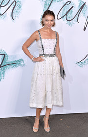 Arizona Muse looked effortlessly chic in a studded white midi dress by Chanel at the Serpentine Galleries Summer Party.