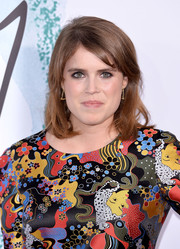Princess Eugenie kept it simple with this subtly wavy hairstyle with side-swept bangs at the Serpentine Galleries Summer Party.